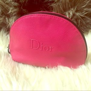Christian Dior makeup pouch. Pink clam shell type.